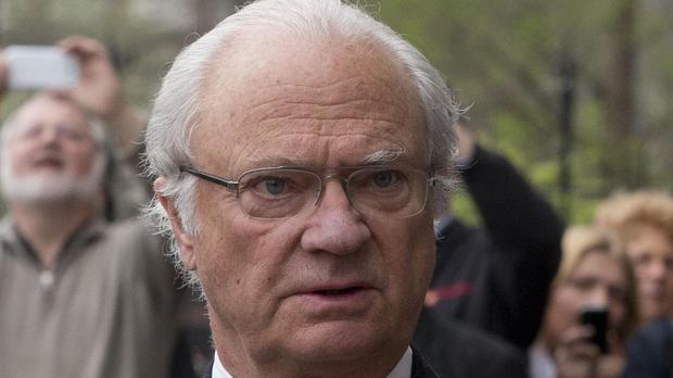 Sweden's King Carl Gustaf was unhurt in the crash, the palace said (AP)