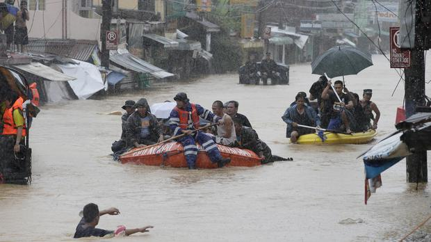 Trapped residents are rescued after heavy monsoon rains spawned by tropical storm Fung-Wong flooded Marikina city (AP