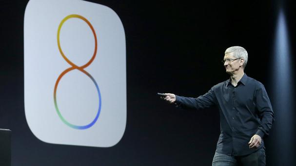 Apple CEO Tim Cook showcases iOS 8 at the Apple Worldwide Developers Conference in San Francisco (AP)