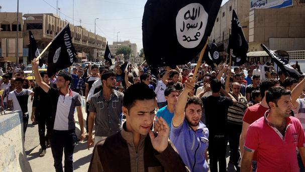 Demonstrators chant pro-Islamic State slogans in front of the provincial government headquarters in Mosul. (AP)