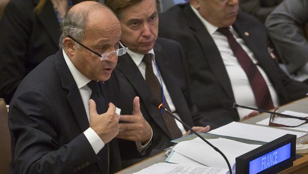 French foreign minister Laurent Fabius has urged the UN Security council to hold back using veto powers over atrocities (AP)