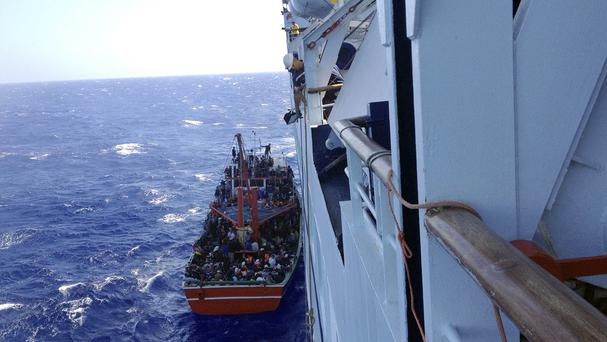 The cruise ship rescued the migrants from a small boat stranded off Cyprus's main port Limassol (AP)