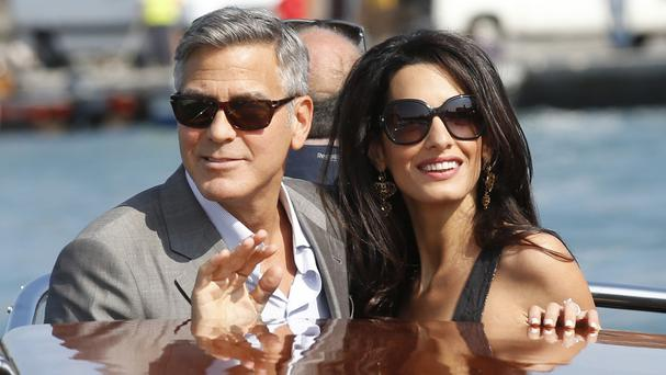 Actor George Clooney and his fiancee Amal Alamuddin arrive in Venice (AP)