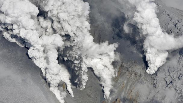 Dense fumes spew from several spots on the slope of Mt Ontake as the volcano erupts in central Japan. (AP)