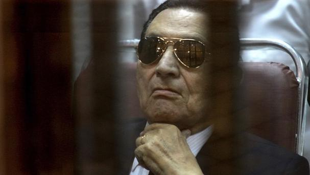 Ousted Egyptian president Hosni Mubarak attends a hearing in his retrial over charges of failing to stop killings of protesters during the 2011 uprising that led to his downfall (AP Photo/Tarek el Gabbas, File)