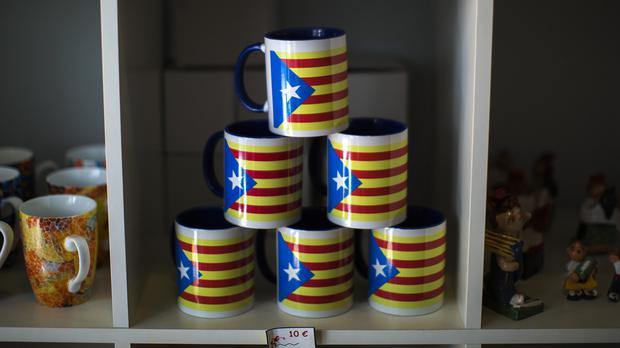 Mugs bearing the estelada flag which symbolises Catalonia's independence. (AP)