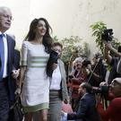 Greek Culture Minister Kostas Tassoulas and lawyer Amal Clooney after their talks about Greece's quest to have the Elgin Marbles returned to Athens (AP Photo/Thanassis Stavrakis)