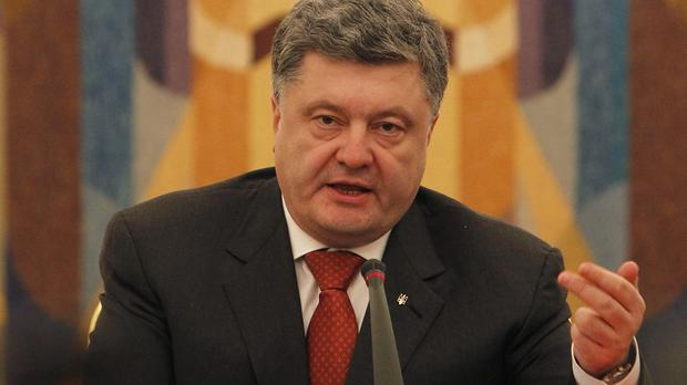President Petro Poroshenko speaks during a meeting of the National Security and Defence Council of Ukraine in Kiev (AP)