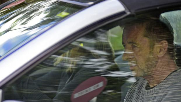 Phil Rudd, the drummer for rock band AC/DC, leaves a court house in Tauranga, New Zealand