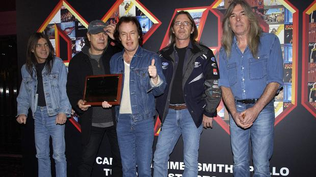 Phil Rudd, fourth from left, with his AC/DC bandmates in 2003