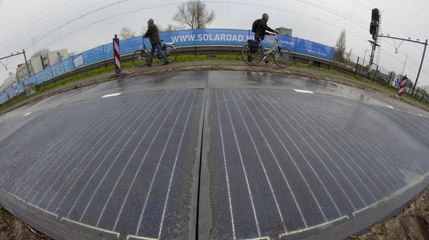 A solar panel cycle path is being constructed in Krommenie, north of Amsterdam in the Netherlands (AP)