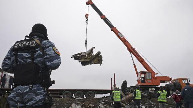 Recovery workers in rebel-controlled eastern Ukraine load debris from the crash site of Malaysia Airlines Flight 17 (AP)
