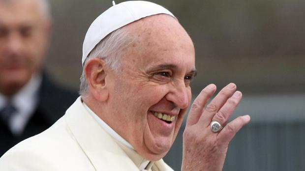Pope Francis waves to officials as he arrives at the European Parliament in Strasbourg (AP)