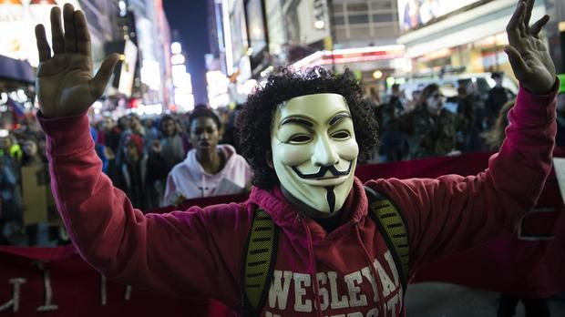 Demonstrators march in New York's Times Square in protest against the grand jury's decision not to indict Darren Wilson (AP)
