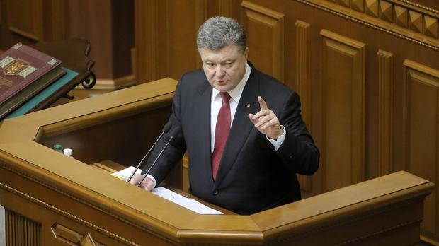 Ukrainian President Petro Poroshenko addresses the opening session of parliament in Kiev (AP)