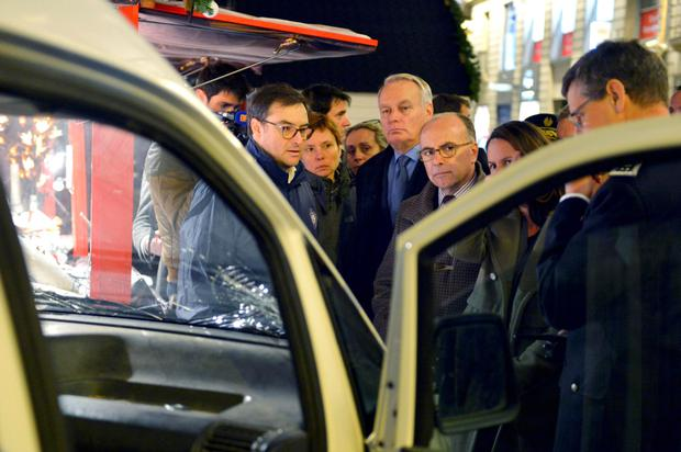 A French official inspects the van that crashed into the market in Nantes (REUTERS/Georges Gobet/Pool)