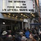 Filmgoers wait in line to see The interview at the Cinema Village theatre in New York (AP)