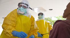 Ebola spreads through direct contact with bodily fluids putting health care workers at higher risk of contracting the virus (AP)