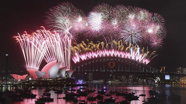 Fireworks explode in Sydney but there were tragic scenes in Shanghai where dozens of revellers died (AP)