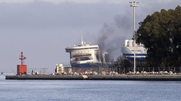 Smoke billows from the Italian-flagged Norman Atlantic ferry in the port of Brindisi in southern Italy (AP)