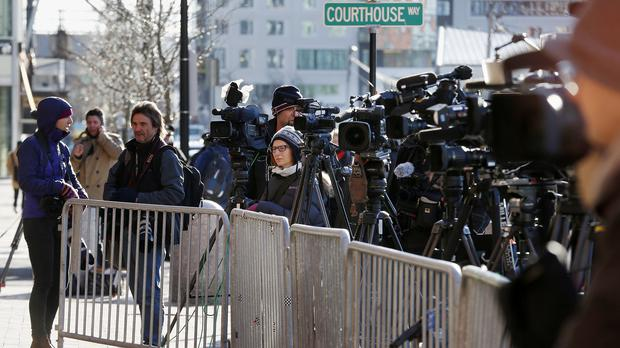 Media take positions outside the federal courthouse in Boston (AP)