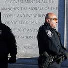 Police officers stand outside the federal courthouse in Boston (AP)
