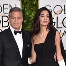 George Clooney and Amal Clooney arrive at the Golden Globe Awards at the Beverly Hilton Hotel (AP)