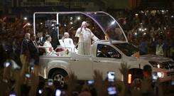 Pope Francis waves to Filipinos upon his arrival in Manila (AP)