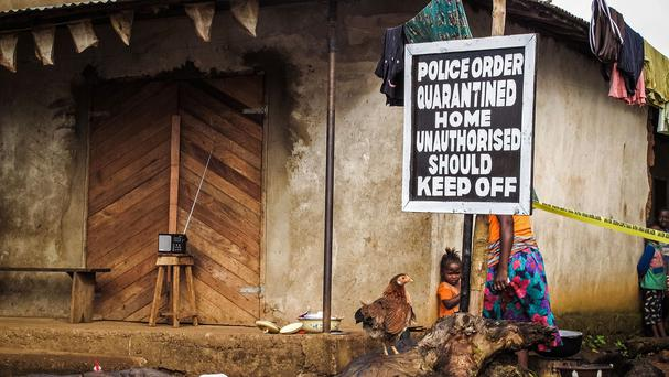 A home in Port Loko, Sierra Leone, is quarantined in an effort to combat the spread of the Ebola virus (AP)