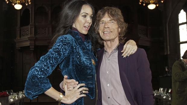 L'Wren Scott and Sir Mick Jagger, pictured in 2012 (AP)