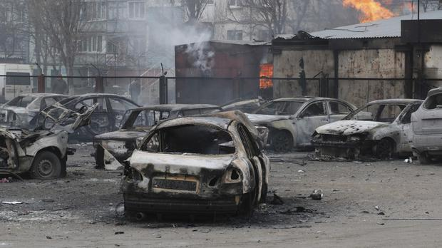 Mariupol came under rocket fire on Saturday morning (AP)