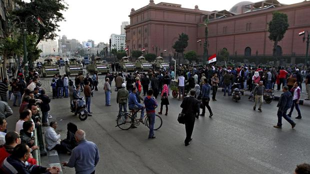 Egyptian police have moved to break up scattered protests marking the anniversary of the 2011 uprising