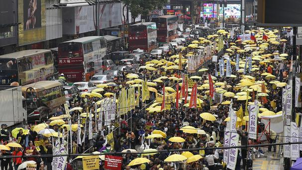 Thousands of pro-democracy activists take part in a march in Hong Kong (AP)