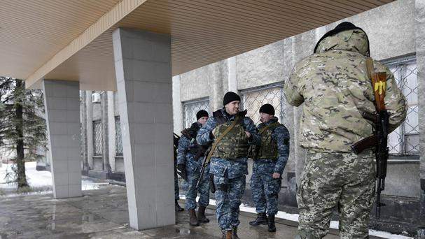 Ukrainian soldiers stand outside a city council building in the town of Debaltseve. (AP)