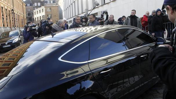 Dominique Strauss-Kahn arrives in a car at the Lille courthouse. (AP)