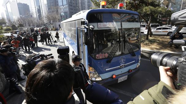 A bus carrying Cho Hyun-ah arrives for her trial at the Seoul Western District Court in Seoul. (AP)