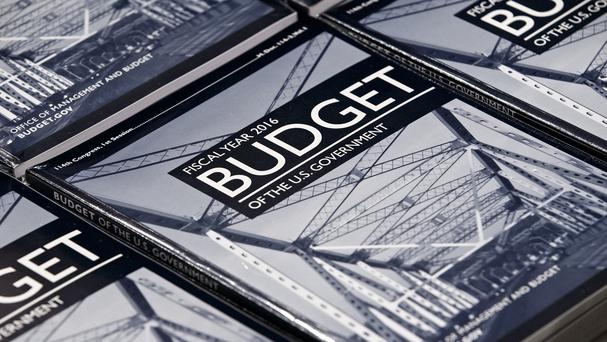 President Barack Obama's new 4 trillion US dollars budget plan is distributed by the Senate Budget Committee. (AP)