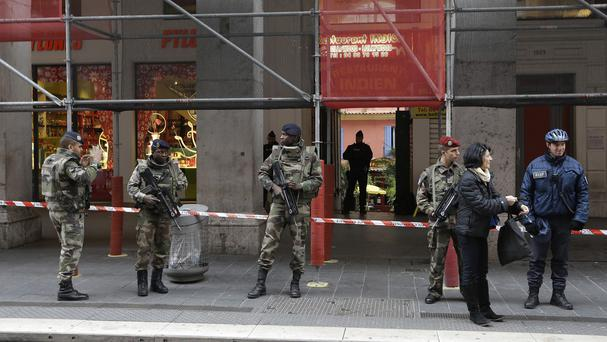 Soldiers stand guard after an attacker with a knife hidden in his bag attacked three soldiers in Nice, southern France (AP)
