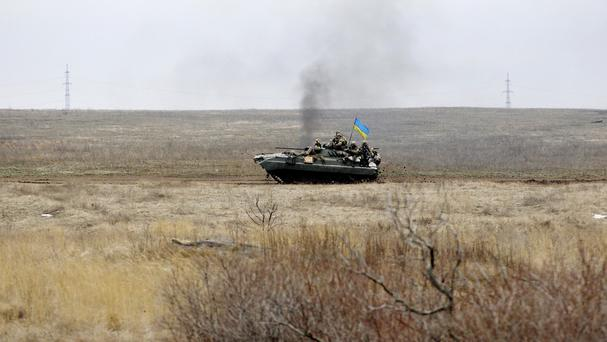 A Ukrainian army vehicle drives through fields near the town of Debaltseve (AP)