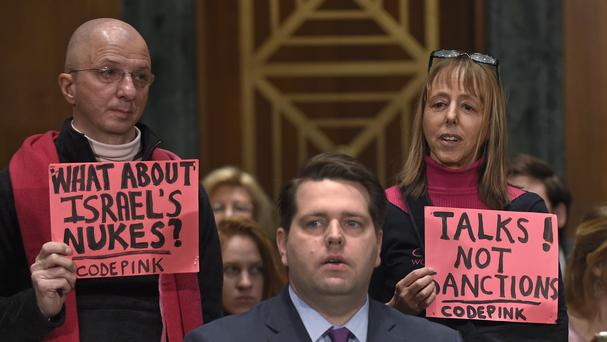 Protesters demonstrate before the start of a US Senate Banking Committee hearing on Iran sanctions (AP)