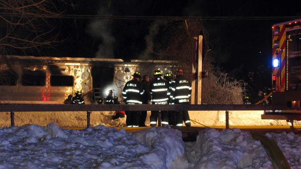 Firefighters work at the scene of the accident in Valhalla. (AP)