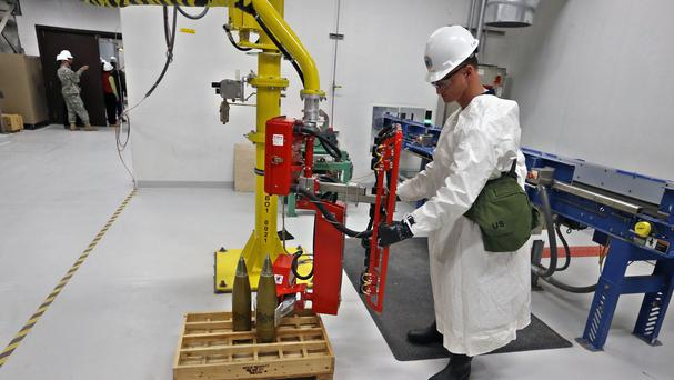 An ordinance technician uses a robot to to handle inert simulated chemical munitions at the Pueblo Chemical Depot (AP)