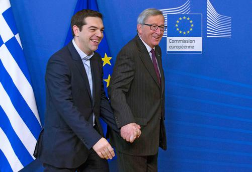 European Commission President Jean-Claude Juncker (R) welcomes Greek Prime Minister Alexis Tsipras (L) ahead of a meeting at the EU Commission headquarters in Brussels February 4, 2015.