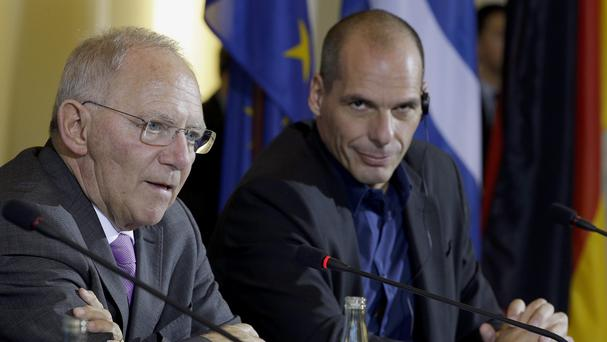 German finance minister Wolfgang Schaeuble and the finance minister of Greece, Yanis Varoufakis, address the media in Berlin (AP)