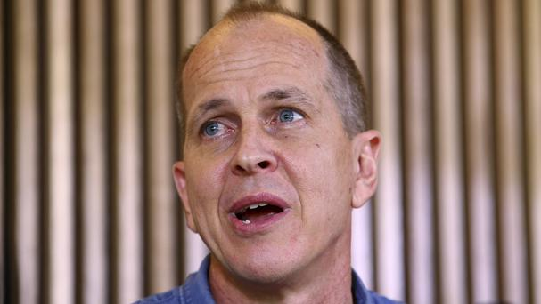 Peter Greste speaks to the media during a press conference in Brisbane, after returning home to Australia (AP)
