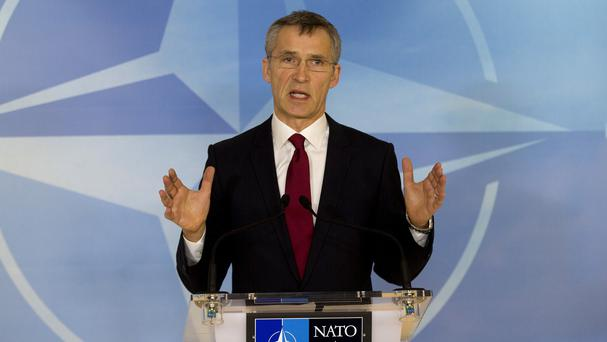 Nato boss Jens Stoltenberg speaks during a media conference in Brussels (AP)