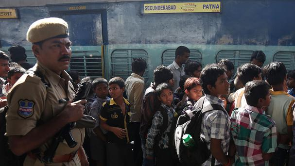 Rescued child workers stand in a queue to board a train to be reunited with their parents in Bihar (AP)