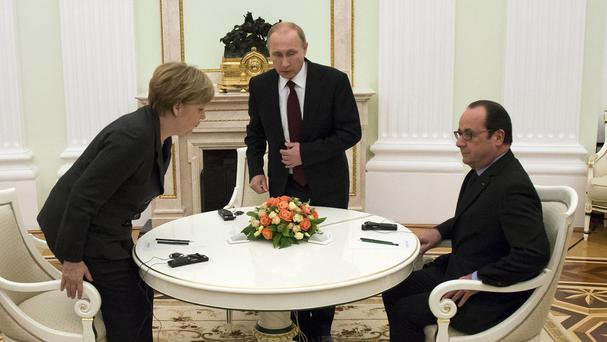 Vladimir Putin with Francois Hollande and Angela Merkel (AP)