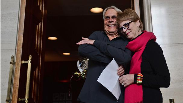 Lee Carter and her husband Hollis Johnson at the Supreme Court of Canada in Ottawa, which struck down a ban on doctor-assisted suicide for mentally competent patients with terminal illnesses (AP/The Canadian Press, Sean Kilpatrick)