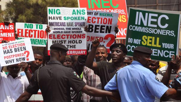 Nigerian police provide security in Abuja 2015, as people demonstrate against any postponement of elections (AP)